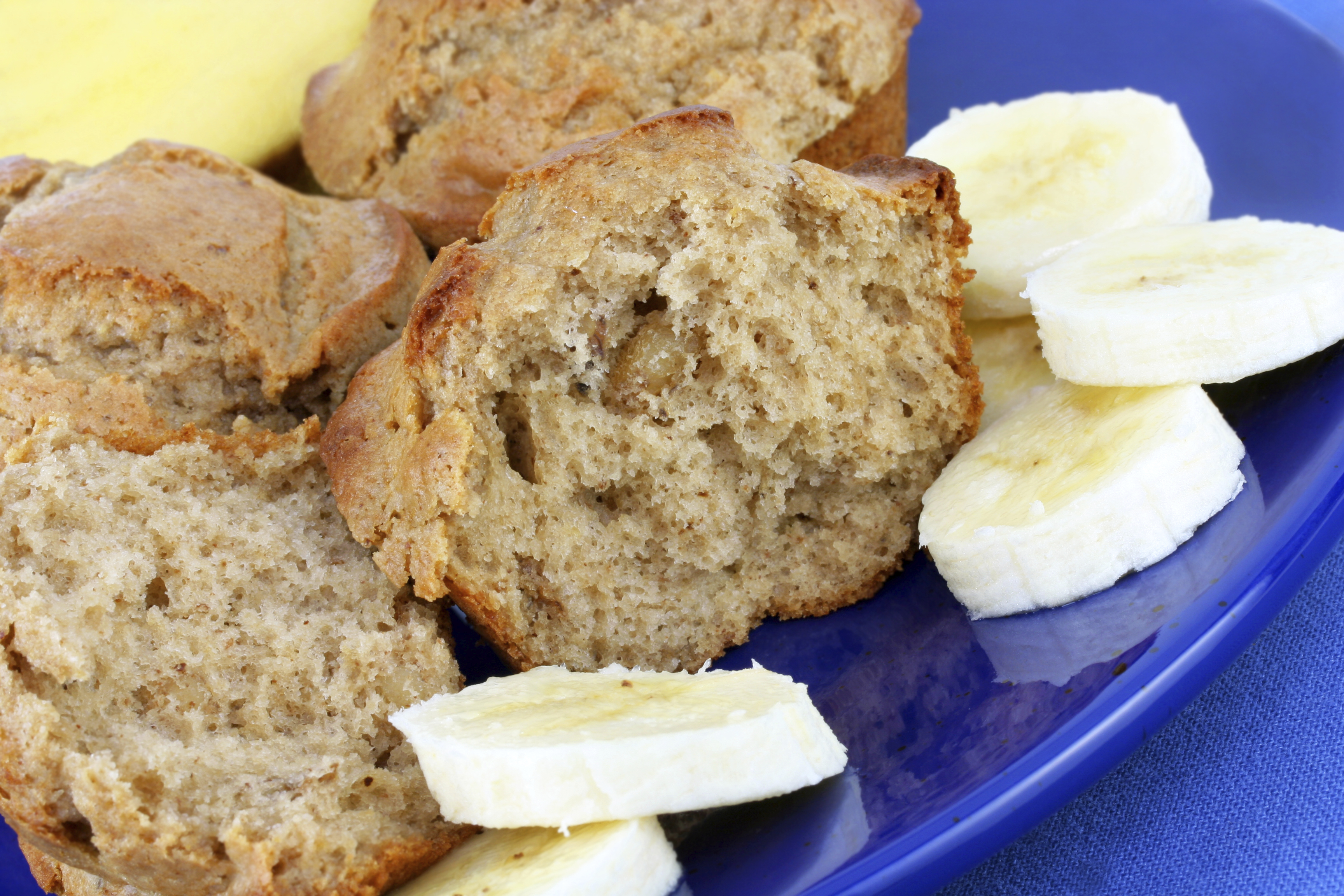Banana muffins, fresh from the oven, with sliced banana.